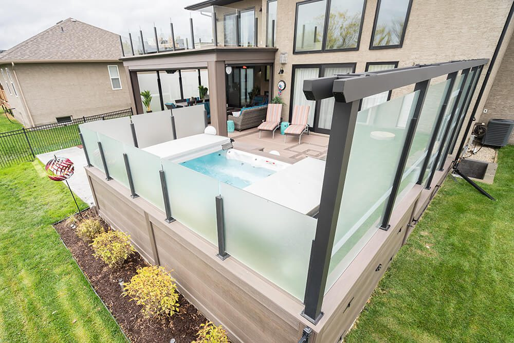 Wolf PVC Serenity Decking, with 12mm tempered glass railing in arbor - Windeck Ltd. - Deck Builder Winnipeg, Manitoba